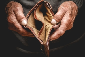 an empty wallet of a man with no financial well-being